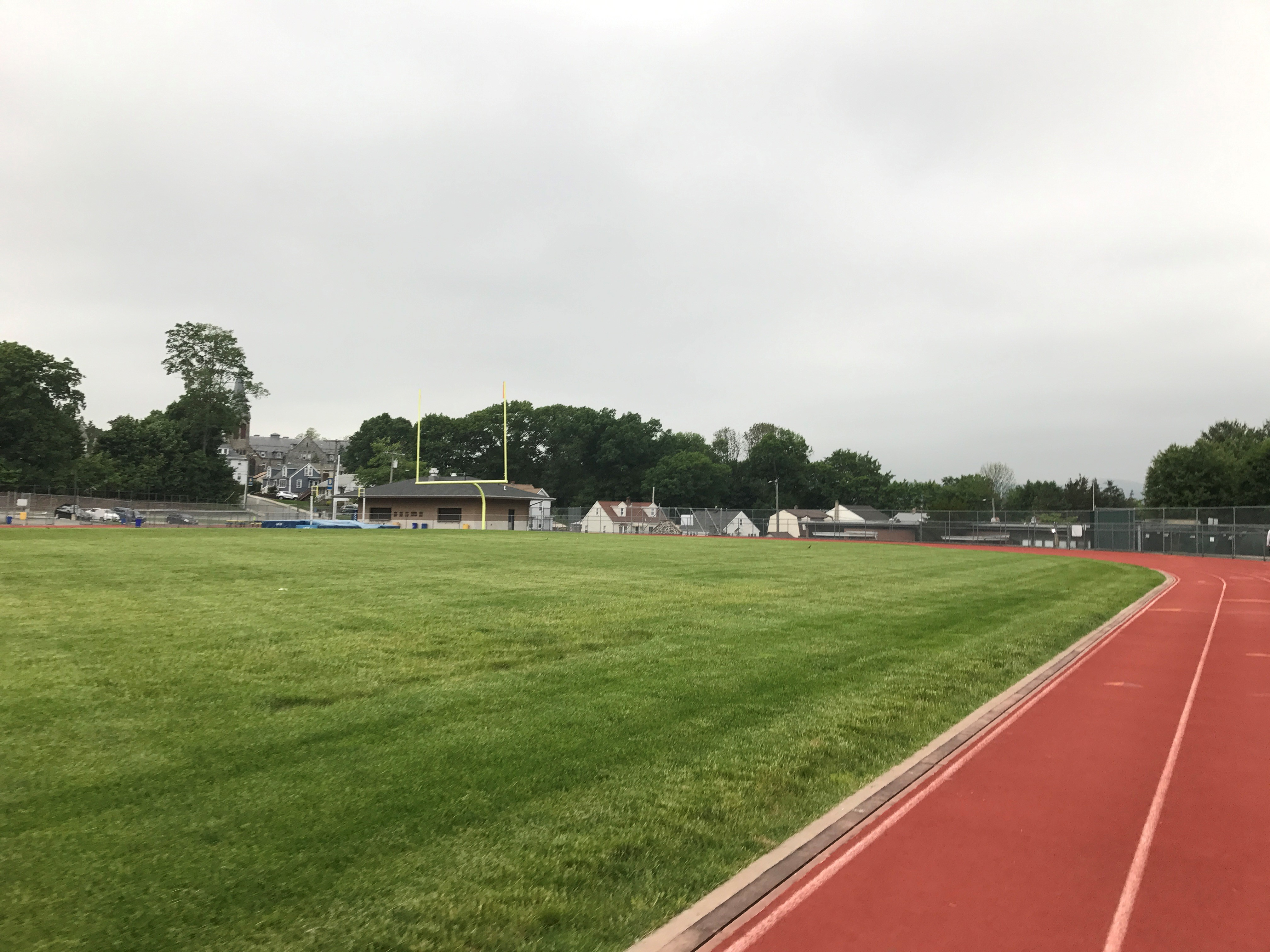 A stormy day at a high school track that could use a weather safety solution for schools